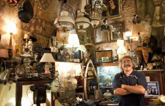 antique store owner in his shop