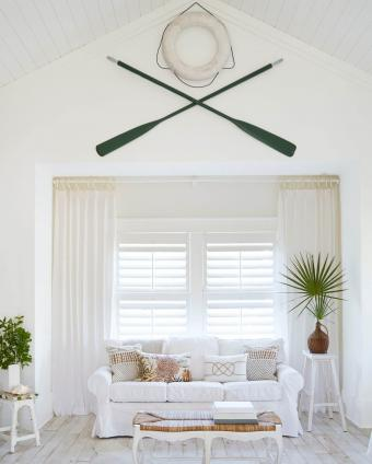 Oars and lifebelt hanging on wall