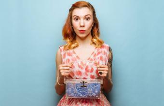 woman with lucite box handbag