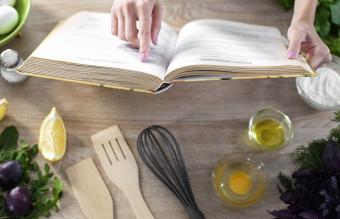 Lady reading in culinary book
