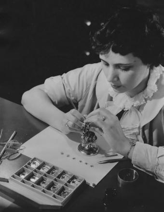 Woman working on a watch at Bulova Watch