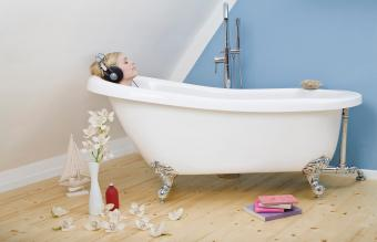 woman relaxing in a clawfoot tub