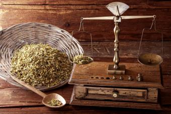 Antique scales weighing Chamomile