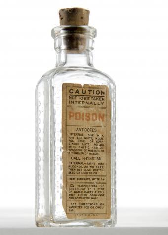 Antique poison bottle with cork shaped like medicine bottle