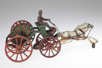 Toy cast iron hose reel wagon of Gainsville swanks