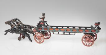 Cast iron toy hook and ladder wagon