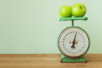 Apples on old-fashioned kitchen scale