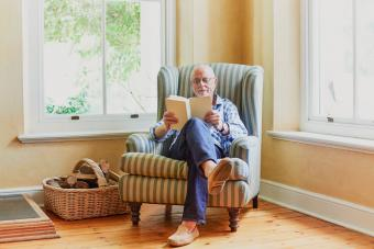 man sitting on wingback chair