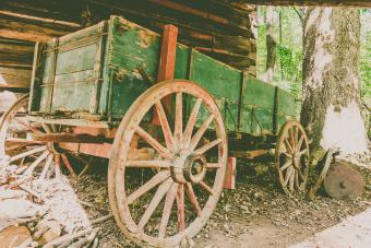 Rustic Wagon Beside Log Cabin