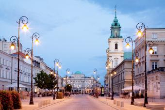 Holy Cross Church and Academy of Sciences in Krakowskie Przedmiescie street at dusk