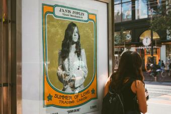 Old poster with Janis Joplin in a street of San Francisco