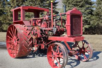 old red tractor with metal wheels