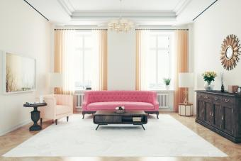 Art deco style living room with pink sofa and armchair