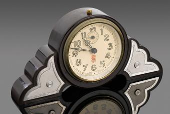 Dark brown, round-faced phenol formaldehyde (Bakelite) clock. France, 1930