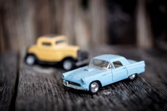 Toy vintage car on wooden background