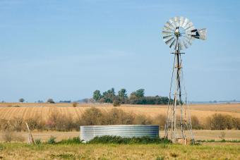 windmill water pump with tank on farm