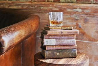 whiskey tumbler on antique books