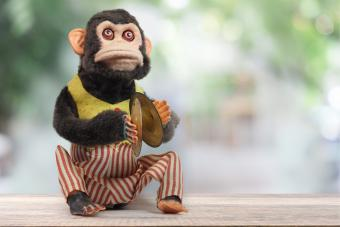 Monkey Playing Cymbals Vintage Toy: Companies & History