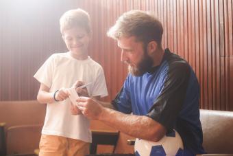 Soccer player giving an autograph