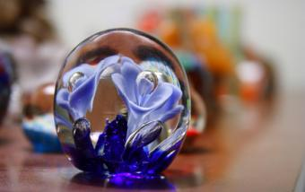 An antique paperweight with floral design.
