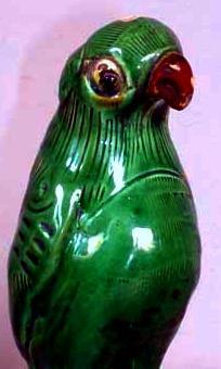 Antique parrot figurine