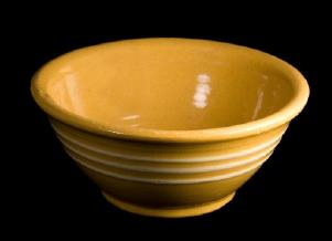 A banded yellow ware bowl