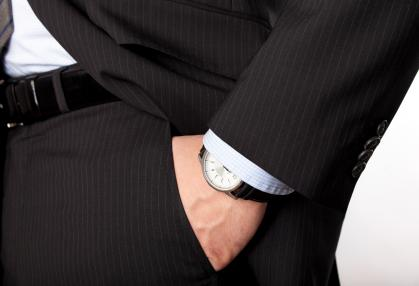 Man with hand in pocket and wearing watch