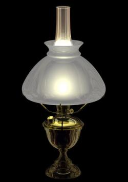 Lit antique brass kerosene lamp with diffused glass lampshade.