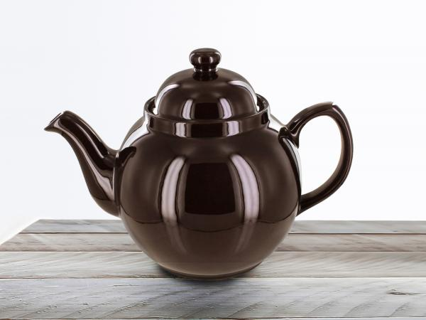 Teapot on wooden table