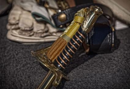 Civil War era sword and gloves