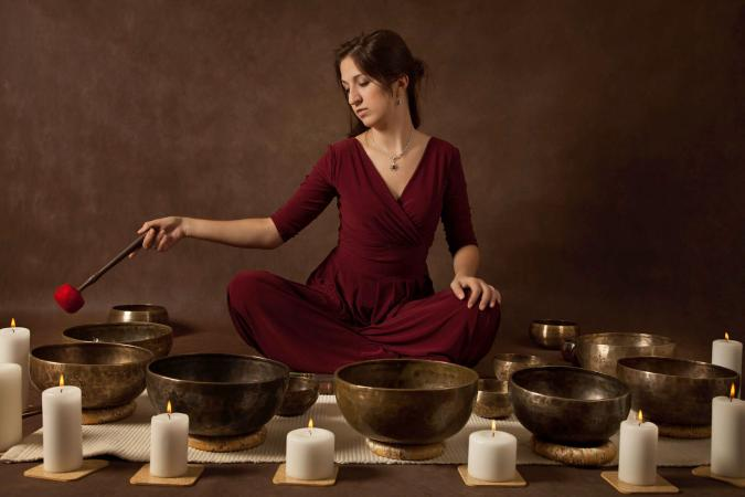 woman playing tibetan singing bowls