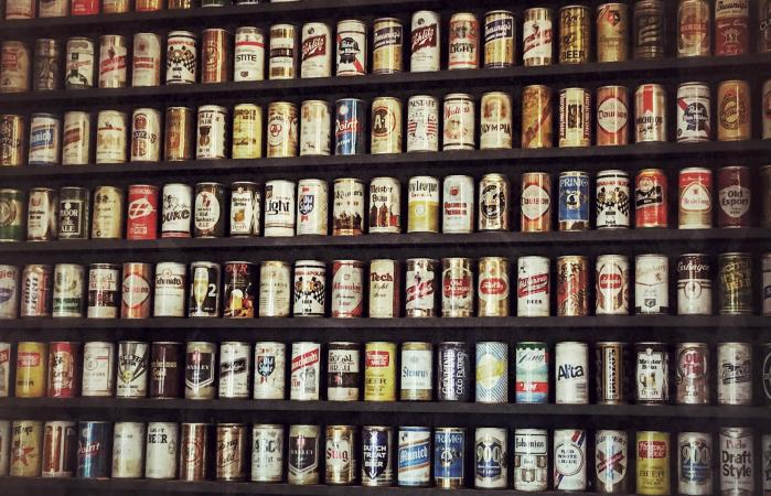 Beer Cans Arranged In Shelves