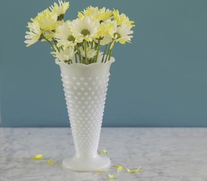 White milkglass hobnail vase with daisies