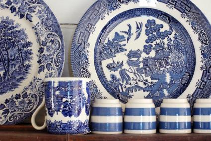 Blue chinaware on old dresser