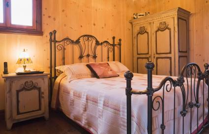 bed with wrought iron headboard