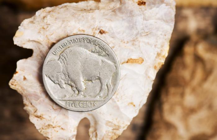 Buffalo Nickle on an arrowhead