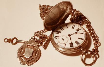 Antique pocket watch with key