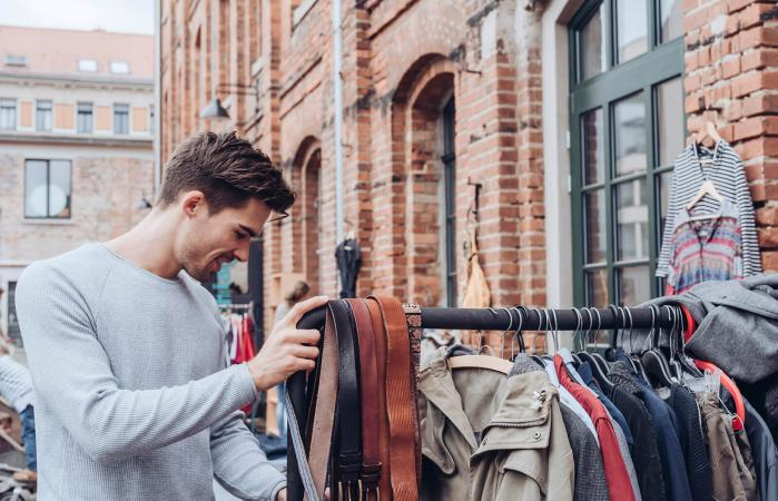 man looking for second hand clothes