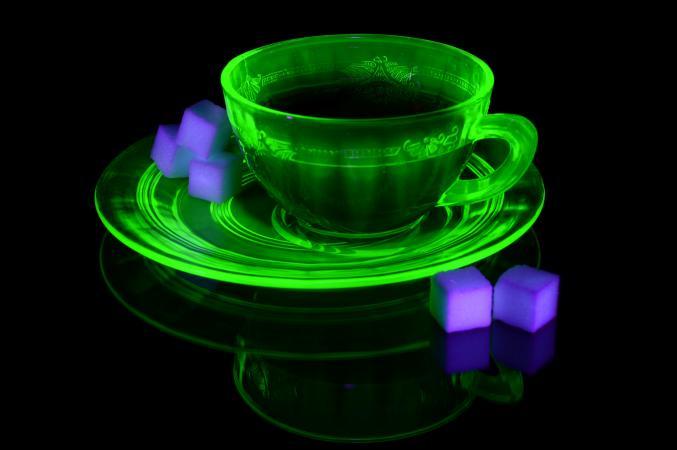 A glowing uranium glass teacup and saucer