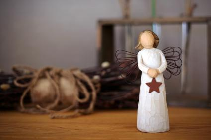 Small Wooden Angel Figurine On Table