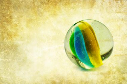 Glass marble on textured background