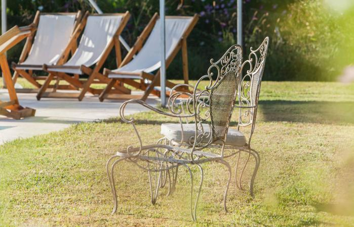 Wrought iron chairs in backyard
