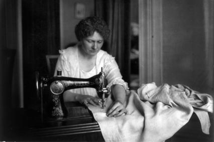 Woman sewing with a Singer sewing machine