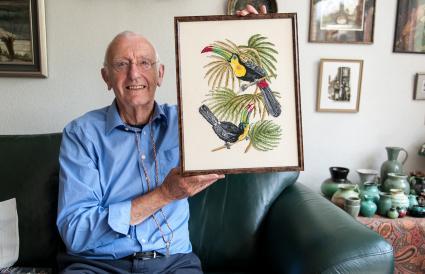 Senior man showing original painting