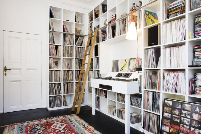 music room featuring record storage in a wall unit