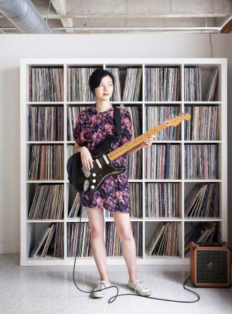 record storage unit and woman playing guitar