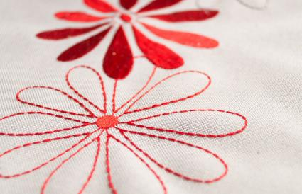 appliqued and embroidered red flowers