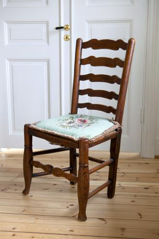 Antique ladder back chair with embroided seat