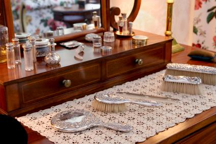 Beauty products on antique dressing table