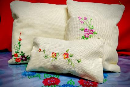 Floral embroidery pattern on pillows